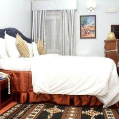 Отель Hoil Suites Нигерия, Калабар - отзывы, цены и фото номеров - забронировать отель Hoil Suites онлайн комната для гостей