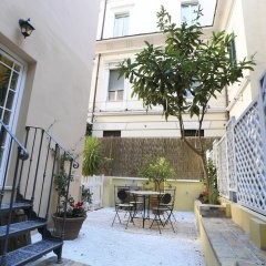 Апартаменты Santi Quattro Apartment & Rooms - Colosseo интерьер отеля