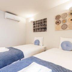 Апартаменты Alfama Cozy Two-Bedroom Apartment w/ River View - by LU Holidays комната для гостей фото 3