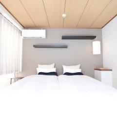 Отель AMP FLAT Nishijin5 Фукуока комната для гостей фото 4