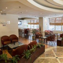 Отель Imperial Suites Hotel ОАЭ, Дубай - отзывы, цены и фото номеров - забронировать отель Imperial Suites Hotel онлайн интерьер отеля
