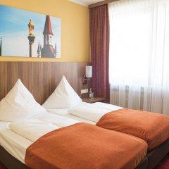 Отель Schlicker - Zum Goldenen Löwen Мюнхен комната для гостей