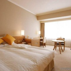 Отель Hilton Fukuoka Sea Hawk Япония, Фукуока - отзывы, цены и фото номеров - забронировать отель Hilton Fukuoka Sea Hawk онлайн комната для гостей фото 3