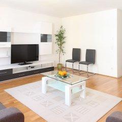 Отель Sunny Apartments - Schoenbrunn Австрия, Вена - отзывы, цены и фото номеров - забронировать отель Sunny Apartments - Schoenbrunn онлайн комната для гостей фото 2