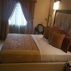 Отель Calabar Harbour Resort SPA Нигерия, Калабар - отзывы, цены и фото номеров - забронировать отель Calabar Harbour Resort SPA онлайн комната для гостей фото 3