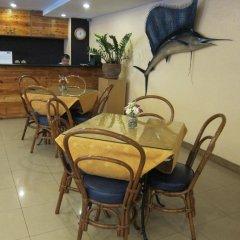 Отель Nichols Airport Hotel Филиппины, Паранак - отзывы, цены и фото номеров - забронировать отель Nichols Airport Hotel онлайн интерьер отеля фото 3