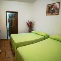 Отель BM Zihua Casa de Huéspedes комната для гостей фото 2