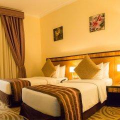 Отель Al Majaz Premiere Hotel Apartment ОАЭ, Шарджа - 1 отзыв об отеле, цены и фото номеров - забронировать отель Al Majaz Premiere Hotel Apartment онлайн комната для гостей фото 3
