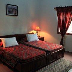 Отель Coconut Grove Beach Resort комната для гостей фото 3