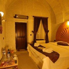 Отель Sakli Cave House Аванос сейф в номере