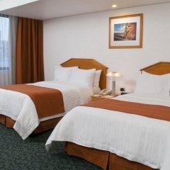 Отель Holiday Inn Dali Airport Мехико комната для гостей фото 4
