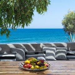 Отель Damma Beachfront Luxury Villa Греция, Остров Санторини - отзывы, цены и фото номеров - забронировать отель Damma Beachfront Luxury Villa онлайн пляж фото 2