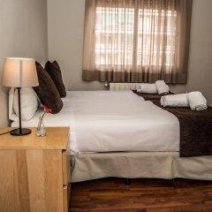 Отель Apartamentos Madanis - Hospitalet de Llobregat Испания, Оспиталет-де-Льобрегат - отзывы, цены и фото номеров - забронировать отель Apartamentos Madanis - Hospitalet de Llobregat онлайн комната для гостей фото 5