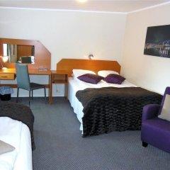 Отель Enter Tromsø Apartments Норвегия, Тромсе - отзывы, цены и фото номеров - забронировать отель Enter Tromsø Apartments онлайн комната для гостей фото 2