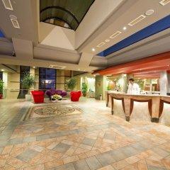 Отель Limak Arcadia Golf & Sport Resort - All Inclusive Белек интерьер отеля