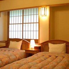 Отель Yamabiko Ryokan Минамиогуни комната для гостей фото 2