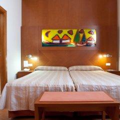 Отель Checkin Valencia Валенсия комната для гостей