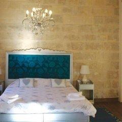 Отель Luciano Al Porto Boutique Accommodation Валетта комната для гостей фото 2