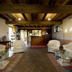 Отель Relais Corte Cavalli Понти-суль-Минчо интерьер отеля