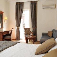 Отель Athens Atrium Hotel and Suites Греция, Афины - 2 отзыва об отеле, цены и фото номеров - забронировать отель Athens Atrium Hotel and Suites онлайн комната для гостей фото 5
