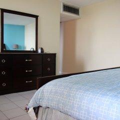Отель Skyclub Beach Suite at Mobay Club Ямайка, Монтего-Бей - отзывы, цены и фото номеров - забронировать отель Skyclub Beach Suite at Mobay Club онлайн сейф в номере