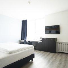 Отель carathotel Düsseldorf City комната для гостей