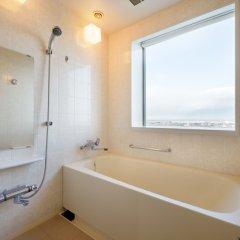 Отель Grand Hotel New Oji Япония, Томакомай - отзывы, цены и фото номеров - забронировать отель Grand Hotel New Oji онлайн ванная