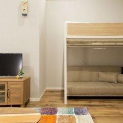 Отель Trip Pod Chiyo B Фукуока комната для гостей фото 5