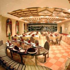 Отель Al Liwan Suites питание фото 2