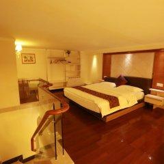 Апартаменты Hakka International Apartment Beijing Rd сейф в номере