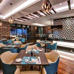 Отель Novotel Sharjah Expo Center ОАЭ, Шарджа - отзывы, цены и фото номеров - забронировать отель Novotel Sharjah Expo Center онлайн гостиничный бар