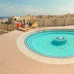Отель Mediterranea Hotel And Suites Мальта, Сан-Пауль-иль-Бахар - отзывы, цены и фото номеров - забронировать отель Mediterranea Hotel And Suites онлайн бассейн фото 3