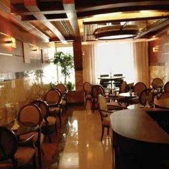 Отель Tulip Inn Sharjah Hotel Apartments ОАЭ, Шарджа - отзывы, цены и фото номеров - забронировать отель Tulip Inn Sharjah Hotel Apartments онлайн питание фото 2
