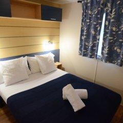 Отель Camping Village Citta Di Milano Италия, Милан - отзывы, цены и фото номеров - забронировать отель Camping Village Citta Di Milano онлайн комната для гостей фото 3