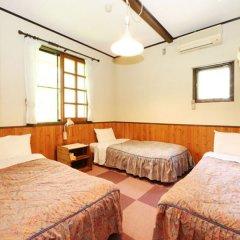 Отель Flower Garden Япония, Минамиогуни - отзывы, цены и фото номеров - забронировать отель Flower Garden онлайн комната для гостей фото 5