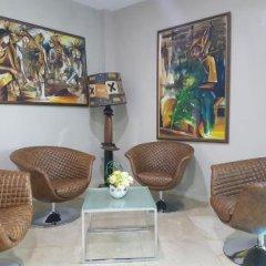 Отель Elbo Suites Республика Конго, Браззавиль - отзывы, цены и фото номеров - забронировать отель Elbo Suites онлайн комната для гостей фото 4
