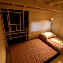 Taketa station hostel cue Минамиогуни комната для гостей фото 2