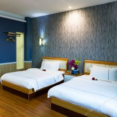Yijia Holiday Hotel комната для гостей