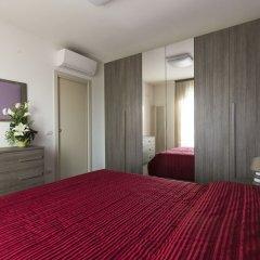 Отель Riva Azzurra Residence Римини комната для гостей фото 3