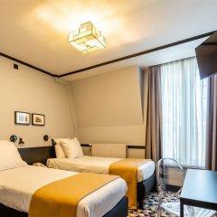 Отель Hôtel des Colonies Бельгия, Брюссель - 8 отзывов об отеле, цены и фото номеров - забронировать отель Hôtel des Colonies онлайн комната для гостей фото 3