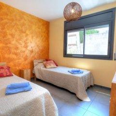 Отель Casa Cap Ras - Four Bedroom Испания, Льянса - отзывы, цены и фото номеров - забронировать отель Casa Cap Ras - Four Bedroom онлайн комната для гостей фото 4
