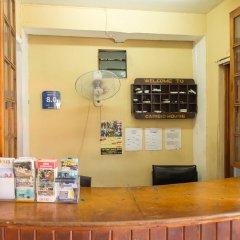 Отель Donway, A Jamaican Style Village Ямайка, Монтего-Бей - отзывы, цены и фото номеров - забронировать отель Donway, A Jamaican Style Village онлайн интерьер отеля