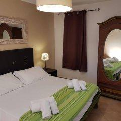 Апартаменты Calipso Apartments Ortigia Сиракуза сейф в номере
