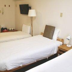 Отель Hukuhuku Guesthouse Хаката комната для гостей фото 4