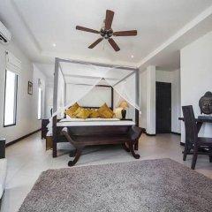 Отель Villa Ploi Attitaya 6 Bed 2 Storey Villa Near Nai Harn Beach Таиланд, Равай - отзывы, цены и фото номеров - забронировать отель Villa Ploi Attitaya 6 Bed 2 Storey Villa Near Nai Harn Beach онлайн комната для гостей фото 3