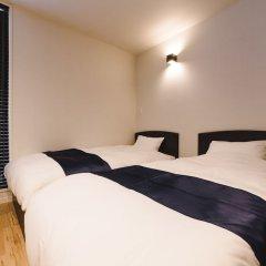 Отель Trip Base HAKATAEKIMAE Хаката комната для гостей