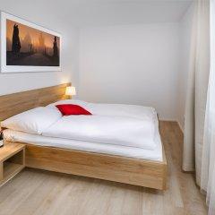Апартаменты CityWest Apartments комната для гостей фото 2