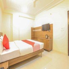 OYO 24565 Hotel Morgan сейф в номере