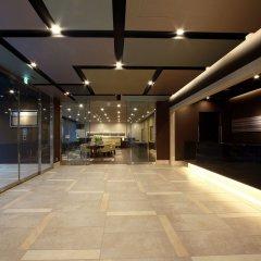Отель Dormy Inn Premium Hakata Canal City Mae интерьер отеля