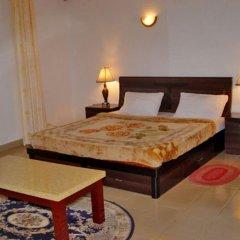 Отель Hilary Hotel Республика Конго, Пойнт-Нуар - отзывы, цены и фото номеров - забронировать отель Hilary Hotel онлайн сейф в номере